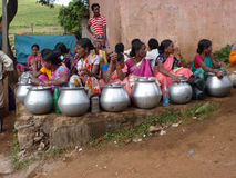 Tribal women sell home brewed liquor Royalty Free Stock Images