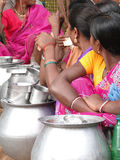 Tribal women sell home brewed liquor Stock Images