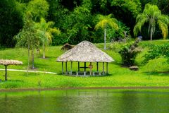 TRIBAL WOODEN SHELTER AT EDGE OF LAKE stock images