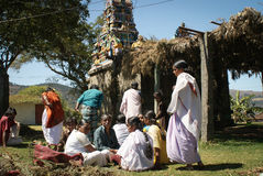 Tribals of India. Group of people belonging to dravidian Kota tribe of South India, Niligiri mountains area, resting in front of an old temple. Ooty area,India Royalty Free Stock Images