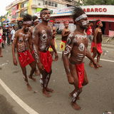 Tribe from Kaimana on Art and Cultural Festival 2017. Men from Kaimana in tribal clothes on a parade. Painted body, headdress and red color are their typical Royalty Free Stock Photos