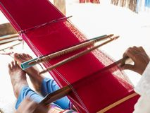 Tribe woman is weaving handicraft work. Tribe Karen woman is weaving handicraft cloth royalty free stock photo