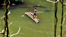 A tribe life in forest. A tribe is doing fishing,bambooraft is boat in the forest and tribe life Stock Photography