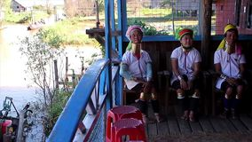 Tribe of  Long Neck women. Myanmar, Yangon. 18.11.2013  Tribe of  Long Neck women. Women with rings on the neck. Tribe Kayan Lahwi stock video footage