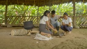 Tribe people cooking food. Indigenous cooking, handicrafts and art on amazonian village in Ecuador stock video footage