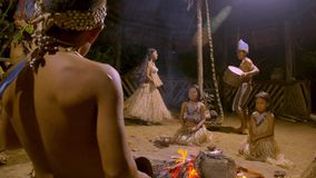 Tribe People Dancing. Aboriginal Culture And Art Show Indigenous Performing Dance And Playing Musical Instrument Traditional Event In Amazonian Jungle By Night stock footage