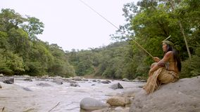 Tribe woman fishing in river. Indigenous tribe people fishing by amazonian river in Ecuador stock video footage