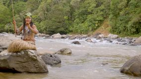 Tribe Woman Fishing In River. Indigenous Tribe People Fishing By Amazonian River In Ecuador stock video