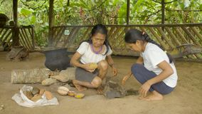 Tribe women cooking food. Indigenous cooking, handicrafts and art on amazonian village in Ecuador stock video footage
