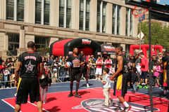 Tribeca family festival. The harlem wizards basketball players playing with kids during tribeca family festival in Greenwich Street,ny royalty free stock images