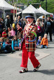 Tribeca Family Festival. Clown performs in front of an audience of parents and kids during the Tribeca Family Festival in in Greenwich Street,NY stock image
