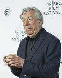 """2015 Tribeca Film Festival. Comedian Terry Jones plays with pieces of a coconut on the red carpet before the screening of """"Monty Python and the Holy Grail"""" Stock Photos"""