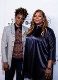 Tribeca Film Festival - Red Carpet before premiere of the Queen Collective. Tribeca Talks - Queen Latifah and Dee Rees at  the  premiere of the Queen Collective royalty free stock photo
