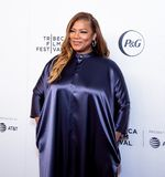 Tribeca Film Festival - Red Carpet before premiere of the Queen Collective. Tribeca Talks - Queen Latifah at  the  premiere of the Queen Collective shorts red stock photography