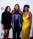 Tribeca Film Festival - Red Carpet before premiere of the Queen Collective. Tribeca Talks - Queen Latifah, Haley Anderson  and Brittany Fennell at  the  premiere royalty free stock image