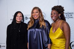 Tribeca Film Festival - Red Carpet before premiere of the Queen Collective. Tribeca Talks - Queen Latifah, Haley Anderson  and Brittany Fennell at  the  premiere stock photos