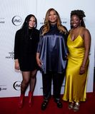 Tribeca Film Festival - Red Carpet before premiere of the Queen Collective. Tribeca Talks - Queen Latifah, Haley Anderson  and Brittany Fennell at  the  premiere royalty free stock images