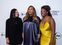 Tribeca Film Festival - Red Carpet before premiere of the Queen Collective. Tribeca Talks - Queen Latifah, Haley Anderson  and Brittany Fennell at  the  premiere stock photography