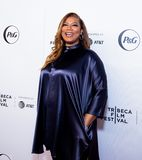 Tribeca Film Festival - Red Carpet before premiere of the Queen Collective. Tribeca Talks - Queen Latifah at  the  premiere of the Queen Collective shorts - Red royalty free stock images