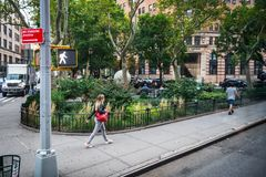 Tribeca Walk. NEW YORK-SEPTEMBER 21: A young woman walks past a beautiful small park in Tribeca on September 21 2018 in lower Manhattan stock images