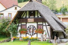TRIBERG, GERMANY - AUGUST 21 2017: Biggest Cuckoo Clock in the W Stock Photos