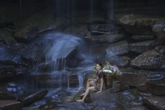 Tribes at waterfall Stock Image