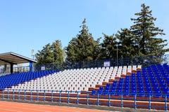 Tribune with chairs at small stadium. Tribune with chairs at small old stadium Royalty Free Stock Photography