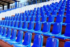 Tribune with chairs at small stadium. Tribune with chairs at small old stadium Royalty Free Stock Photo