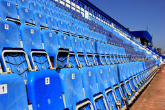 Tribune with folding chairs. At small old stadium Royalty Free Stock Image