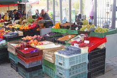 Tribune of fruits, berries and vegetables in the old town of Vilnius, Lithuania. Tribune of fresh fruits and vegetables in the eOld town of Vilnius, Lithuania Stock Image