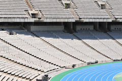 Tribune seats. Olympic stadium with empty tribune seats and running track in Barcelona, Spain Stock Images
