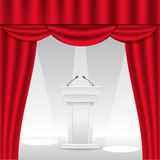 Tribune on stage with red curtain. Stock Photo
