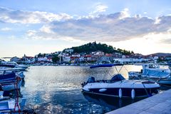 The Tribunj cityscape, Croatia. The promenade and cityscape of Tribunj at summer evening royalty free stock images