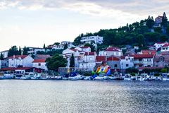 The Tribunj cityscape, Croatia. The promenade and cityscape of Tribunj at summer evening royalty free stock photos