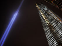 Tribute in Light and One World Trade Center. Tribute in Light art display next to the One World Trade Center building in the WTC complex in Manhattan at night on Royalty Free Stock Photography