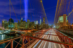 Tribute in Light - September 11. New York City Manhattan downtown skyline at night from the Brooklyn Bridge with the Tribute in Light in memory of September 11 Royalty Free Stock Image
