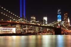 Tribute in Lights with Freedom tower and Brooklyn bridge. Royalty Free Stock Images