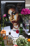 Tribute to Amy Winehouse. LONDON - JULY 27: Her fans pay tribute to Amy Winehouse in front of her house on Camden square, on July 27, 2011 in London. Amy Royalty Free Stock Images