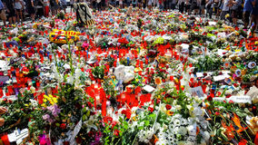 Tribute to the victims of Barcelona terrorist attack. BARCELONA, SPAIN - AUGUST 22, 2017: citizens from all around the world laying flowers and lighting candles Stock Photo