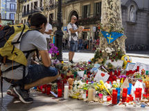 Tribute to the victims of Barcelona terrorist attack. BARCELONA, SPAIN - AUGUST 22, 2017: citizens from all around the world laying flowers and lighting candles Stock Photography