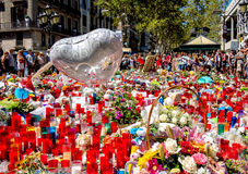 Tribute to the victims of Barcelona terrorist attack. BARCELONA, SPAIN - AUGUST 22, 2017: citizens from all around the world laying flowers and lighting candles Royalty Free Stock Images