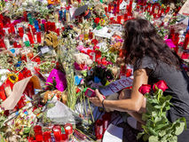 Tribute to the victims of Barcelona terrorist attack. BARCELONA, SPAIN - AUGUST 22, 2017: citizens from all around the world laying flowers and lighting candles Royalty Free Stock Photos
