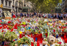 Tribute to the victims of Barcelona terrorist attack. BARCELONA, SPAIN - AUGUST 22, 2017: citizens from all around the world laying flowers and lighting candles Stock Photos