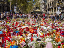 Tribute to the victims of Barcelona terrorist attack. BARCELONA, SPAIN - AUGUST 22, 2017: citizens from all around the world laying flowers and lighting candles Stock Image