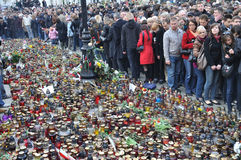 Tribute to victims of the plane crash. A crowd gathered outside of the presidential palace in Warsaw in memory of Polish President and the other victims of the Royalty Free Stock Photo