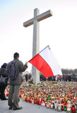 Tribute to victims of the plane crash. Mourners light candles under a giant cross at Pilsudski Square in memory of Polish President and the other victims of the Royalty Free Stock Photography