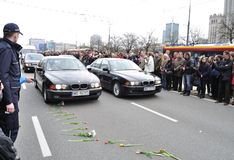 Tribute to victims of the plane crash. Cars following the hearse with the coffin Polish president, that was killed in a plane crash in Russia (April 10, 2010 Stock Images