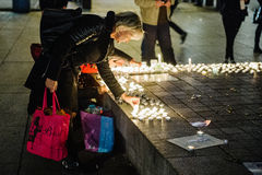 Tributes being laid out after the Paris attacks Paris attacks af Royalty Free Stock Images
