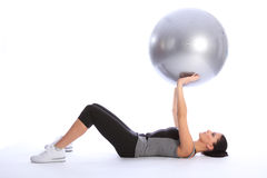 Tricep brachii muscle exercise with fitness ball Royalty Free Stock Photos