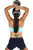 Tricep Dumbbell Extension. Woman lifiting free weights over head.  Back view over white. Tricep Dumbbell Extension Royalty Free Stock Photo